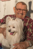 Old Man with Dog Stock Image