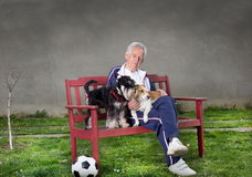 Old man with dogs Royalty Free Stock Photography