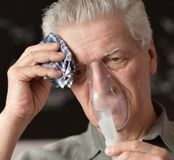 An old man doing inhalation Royalty Free Stock Photos