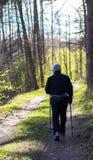 Old man doing Nordic walking Stock Image