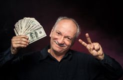 Old man with dollar bills Stock Images