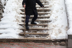 The old man down the stairs slippery in winter Stock Images