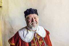 Old man dressed in medieval clothes in Rothenburg Royalty Free Stock Photos