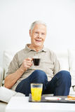 Old man drinking coffee for breakfast Royalty Free Stock Image