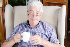 Old man drinking coffee. Royalty Free Stock Photography