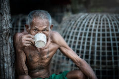 Old man drinking coffee Royalty Free Stock Image