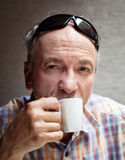 Old man drinking cup of coffee Royalty Free Stock Image
