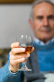 Old man making a toast. Old man drinking a glass of whiskey Royalty Free Stock Images