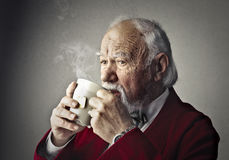 Old man drinking Royalty Free Stock Photos