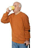 Old man drinking tea Stock Photography