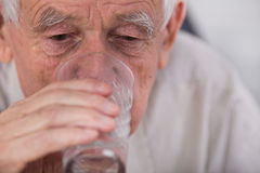 Old man drinking water Stock Photos