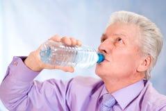 Old man drinks Stock Photo