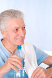 Old man drinks water Stock Photo