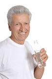 Old man drinks water Royalty Free Stock Photo
