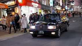 An Old Man driving a black taxi stock photography