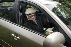 Old man driving a car Royalty Free Stock Photos