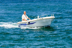 Old man driving motorboat Royalty Free Stock Photo