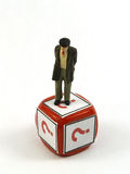 Old man dudes. Litle old man figure on a red die with question simbol royalty free stock image