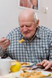 Old man eating Royalty Free Stock Photo