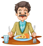 Old man eating pizza on the table Royalty Free Stock Photos