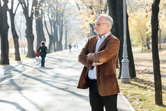 Old man elegant dressed  standing outside Royalty Free Stock Photo