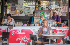 An old man are enjoying morning coffee in thai antique cafe. Stock Photos