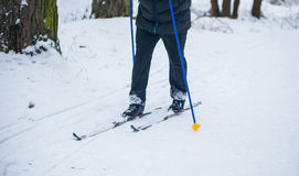 An old man exercises to improve his health by cross country skiing Stock Photos