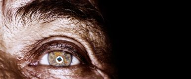 Old man eye. In macro,sun burned and wrinkled skin Royalty Free Stock Photography
