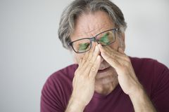 Old man with eye fatigue royalty free stock images