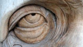 Old man eye wood carving Stock Photos