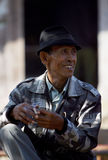 Old man faces. A goat trader in Boyolali, Central Java, Indonesia Royalty Free Stock Photo