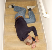 Old man fallen downstairs unconscious Royalty Free Stock Images
