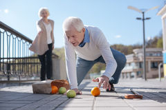 Old man falling down in the street Royalty Free Stock Photos