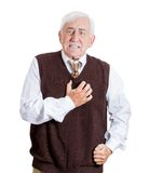 Old man feeling bad. Closeup portrait of elderly male executive, old corporate employee having sudden chest, heart pain, heartburn, trying to catch his breath Stock Photography