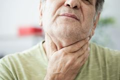 Old man feeling painful in the throat royalty free stock photos