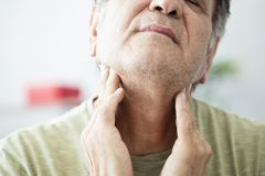 Old man feeling painful in the throat royalty free stock images