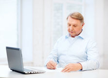 Old man filling a form at home Royalty Free Stock Image