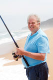 Old man fishing. On beach Royalty Free Stock Photography