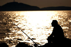 Old man fishing Royalty Free Stock Images
