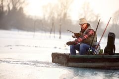 Old man fishing in boat Royalty Free Stock Images