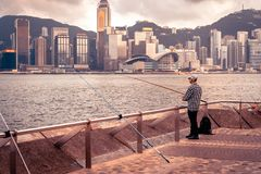 Hong Kong, China - Old man fishing in the harbour stock photos