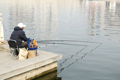 an old man fishing in Haihe Stock Photo