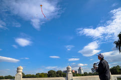 An old man is flying kite Stock Photography