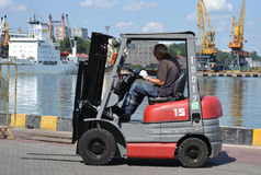 Old man in a Forklift Royalty Free Stock Photo