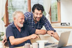 Free Old Man Fun Smile Happy To Looking At Laptop With Son. Using Communication Technology For Family Happiness Elder Home Care To Stock Photography - 171781792