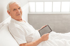 Old man with gadget Stock Image