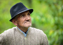 Old man in the garden Stock Image