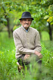 Old man in the garden Stock Photo