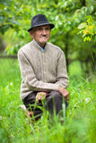 Old man in the garden Stock Photography