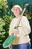 Old man with gardening tool Stock Photography